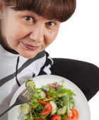 Pension age woman in sport costume with salad. Healthy life style concept — Stock Photo