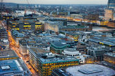 LONDON, UK - JANUARY 27, 2015: Busy streets of City of London in the dusk. First evening lights and sunset. London's panorama from the St. Paul cathedral — Stock Photo