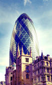 LONDON, UK - APRIL 24, 2014: City of London one of the leading centres of global finance, headquarters for leading banks, insurance, stock exchange, media, law and other businesses. Gherkin building — Stock Photo