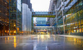LONDON, UK -  MARCH 28, 2015: Heathrow airport Terminal 5 new square with fountains and wet reflected floor. — Stock Photo