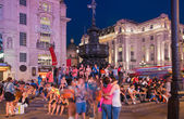 LONDON, UK - AUGUST 22, 2014: Piccadilly Circus in night. Famous place for romantic dates. Square was built in 1819 to join of Regent Street — Stock Photo