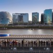 LONDON, UK - APRIL15, 2015: Modern buildings on the south bank of river Thames walk. Office centre, theatre and  London city hall building in sun set — Stock Photo #70733149