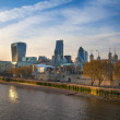 LONDON, UK - APRIL15, 2015: City of London and Tower on the river Thames in sun set light — Stock Photo #70742009