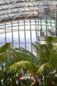 LONDON, UK - APRIL 22, 2015: People in the restaurant of the Sky Garden Walkie-Talkie building. Viewing platform is heist UK garden, locates at the 32 floor and offers amazing skyline of London city. — Stock Photo