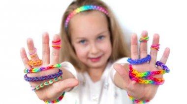 Loom bands craft. Little girl demonstrating her works. — Stock Video