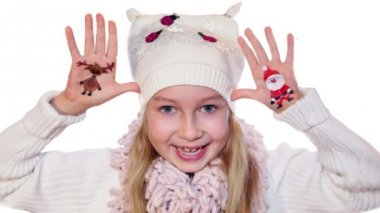 Happy girl demonstrating painted Christmas symbols on her hands. Santa and reindeer — Stock Video