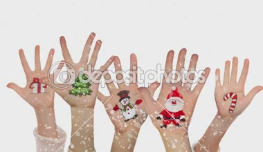 Children's hands raising up with painted Christmas symbols: Santa Claus, Christmas tree, Snow man,  present box — Stock Video