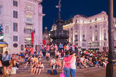 LONDON, UK - AUGUST 22, 2015: Piccadilly Circus in night. Famous place for romantic dates. Square was built in 1819 to join of Regent Street — Stock Photo