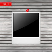 Photo frame with red pin isolated on a wooden background — Stock Vector