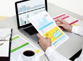 Analyzing Data Hands with Financial Charts — Stock Photo