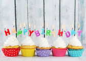 Colorful happy birthday candles — Stock Photo