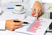Businesswoman analysing statistics — Stock Photo