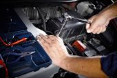 Hands of car mechanic in auto repair service. — Stock Photo