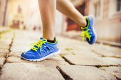 Runner athlete feet running on road — Stock Photo