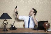 Businessman talking on the phone obnoxious customer — Stock Photo