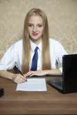 Young worker signs a new contract — Stock Photo