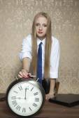 Business woman with the clock — Stock Photo
