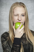 Beautiful business woman eating an apple — Stock Photo