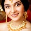 Beauty sweet indian girl in sari smiling close up — Stock Photo #51900461