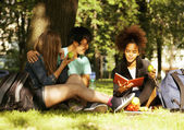 Cute group of teenages at the building of university with books huggings, diversity nations — Stock Photo
