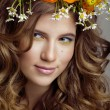Beauty young woman with flowers and make up close up, real spring beauty — Stock Photo #52694501