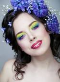 Beauty young woman with flowers and make up close up, real spring beauty — Stock Photo