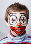 Little cute boy with facepaint like clown, pantomimic expressions close up — Stock Photo