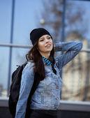 Cute brunette teenage girl in hat, student outside — 图库照片