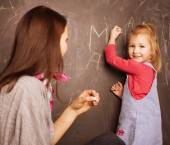 Teacher with pupil in classroom — Stock Photo