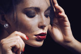 Beauty brunette woman under black veil with red manicure close up — Stock Photo
