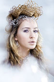 Beauty young snow queen in fairy flashes with crown on her head — Stock Photo