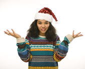 Cute young girl in santas red hat isolated — Stock Photo