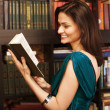 Stock photo portrait of beauty young woman reading book in library — Stock Photo #54325203
