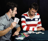 Young people playing poker — Stock Photo