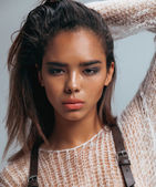 Beauty young afro woman in sweater close up — Stockfoto