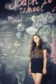 Back to school after summer vacations, cute teen girl in classroom — Stock Photo