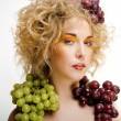Cute blond woman with creative make up and grapes isolated — Stock Photo #56014105
