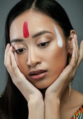 Beauty young asian girl with make up like Pocahontas, red indians woman — Stock Photo