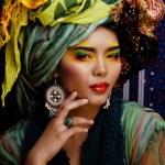 Beauty bright woman with creative make up, many shawls on head like cubian, ethno — Stock Photo #57548597
