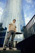 Young man stand in front of modern business building — Stock Photo
