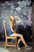 Back to school after summer vacations, cute teen real girl in classroom — Foto de Stock