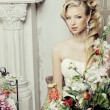 Beauty young bride alone in luxury vintage interior with flowers — Stock Photo #58576649