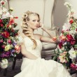 Beauty young bride alone in luxury vintage interior with flowers — Stock Photo #58576707