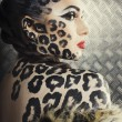 Young sexy woman with leopard make up all over body, cat bodyart closeup — Stock Photo #59419603