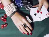 Hands of young caucasian woman with red manicure at casino table close up — Stock Photo