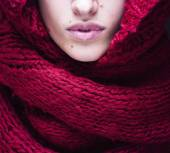 Young pretty woman lips in sweater and scarf all over her face — Stock Photo