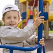 Little cute boy playing on playground, hanging on gymnastic ring — Stock Photo #60139105