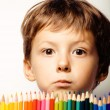 Little cute boy with color pencils close up smiling — Stock Photo #60139389