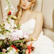 Beauty young bride alone in luxury vintage interior with a lot of flowers — Stock Photo #60330871