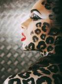 Young sexy woman with leopard make up all over body, cat bodyart — Stock Photo